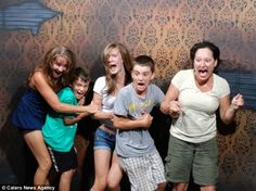 Hilarious: A family cling together for comfort as they scream in surprise