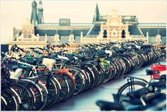The bike is the most used means of transportation in Amsterdam. Its streets are full of them! #travel #Amsterdam #bike