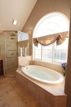 spacious standing shower and bath tub