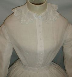 "Bodice detail - Heavenly 1860s Civil War Era White Cotton Dress | eBay seller fiddybee, waistband decorated with eyelet trim, front button closure on bodice, armscyes piped, cartridge pleating, skirt unlined, very good, clean condition, no age spots or underarm discoloration; 2 tiny pea sized holes in skirt; bust: 34""; waist: 22""; skirt length: 39.5""; hemline width: 126."""
