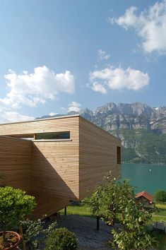 """Austrian studio k_m architektur has designed the Wohnhaus Am Walensee project. Completed in 2007, this two story contemporary home is located in Unterterzen, a small village on Walensee lake, one of the largest lakes in Switzerland.                       Wohnhaus Am Walensee by K_M Architektur: """"The location alone of this single family home in Unterterzen, with a clear view of lake Walensse and the mountains of Churfirsten is spectacular. The property which is located on the slope of a green…"""
