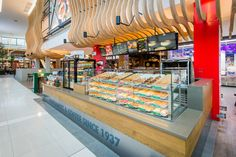 The kiosk fits seamlessly within the mall timber structures, giving the kiosk a more prominent presence within the mall food court.  #Design #InteriorDesign #HospitalityDesign #SouthAfrica #Architecture #DesignThatWorks #DesignforEveryone #foodandbeverage #ExperienceDesign #DesignPartnership #RestaurantDesign #DesignPhotography #DesignInspiration #ConceptualDesign