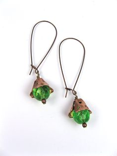 Add more visual interest to earrings by punching little holes in bead caps.