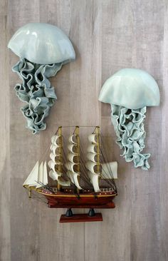 Jellyfish wall sculpture, single. Dimensional wall art for a pop of fun. If youre looking for unique gallery wall art ideas, these have a unique texture for coastal, pirate, or ocean themed decor. Waterproof and mold proof for bathrooms or outdoor use. Great pool house decorations