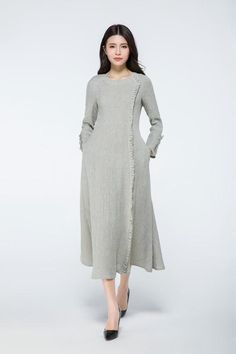 This dress is very ease to wear and beautiful The dress is suitable for any shaped lady. This is a really versatile but unique designer dress.this versatile designer dress can be worn both for daytime or to a party in the evening. Simply pair with the right accessories to dress it up or down depending on the occasion. Details: Gray linen dress; Dress with long sleeves Closed by zipper Length is about 124.5cm in the photo . SIZES: SIZE XXS (US 0, UK 4, Italian 34, French 32, German 30…