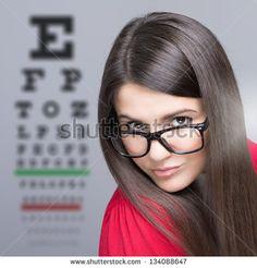 Woman taking an eye vision test Vision Eye, Stock Photos, Eyes, Women, Cat Eyes, Woman