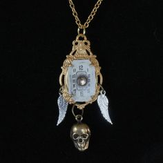Skull Wings and Time Necklace by oscarcrow on Etsy, $25.00