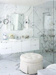 Marble wall, floating vanity, exposed plumbing shower system    Betty Burgess Veranda magazine