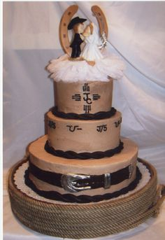 "western wedding cake pictures | Western style wedding cake. Chocolate icing with fondant ""rope"". The ..."