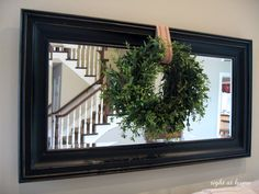 Mirror + Wreath for over the couch