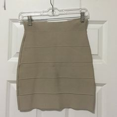 BGBG MAXAZRIA Simone Skirt BGBG tan bandage skirt. Runs TTS ( similar to size 2) BCBGMaxAzria Skirts Mini