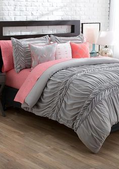With this solid, textured comforter mini set, you can create an ensemble true to your style! Choose from white, gray or coral to get started, then mix and match with the decorative pillows any way you want.