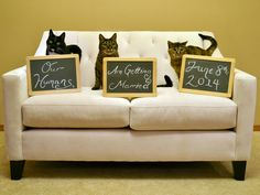 """Our cats Goomba, Koopa, and Peach sit on the couch to announce our wedding! Their chalkboards read, """"Our Humans Are Getting Married June 8, 2014."""" We mailed this picture of our pets in our save the date cards."""