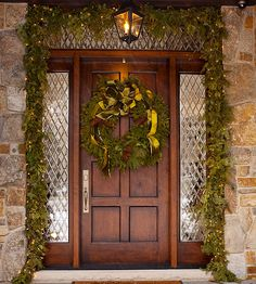 Christmas: Charming Christmas Front Porch Decorating Ideas Bringing The Holiday Feelings, Natural Christmas Decorations Touches for Front Porch with Greenery Garland and Huge Wreath Decorate On The Front Door also Ceiling Sconce Light