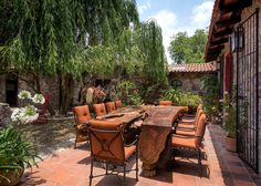 At this Sofía Aspe–designed homestead on a ranch in Querétaro, Mexico, the stable dining area features a table from Bali that weighs more than pounds and seats The custom wrought-iron chairs are by local maker Dewayne Youts. Teak Dining Table, Outdoor Dining, A Table, Outdoor Decor, Outdoor Ideas, Dining Area, Outdoor Spaces, Wrought Iron Chairs, Rustic Stone