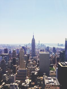 Original Shot: Downtown Manhattan and the Empire State Building. Gorgeous blue skies as far as the eye can see! Taken from the Top of The Rock