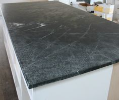 This is what we like!  Black soapstone countertops with off white cabinets