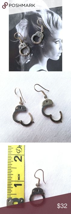 """Sterling Handcuff Earrings Totally """"Fifty Shades of Gray"""" sterling silver handcuff earrings. They open and close! If you look closely again the right one in the second pic, the raised """"button"""" is dented in. Small detail but still want to mention.  That aside, these are in great condition! Maybe happened in my jewelry box somehow. Totally unique earrings. 😊  Approx 1.5"""" long total   Punk Rock Rocker Goth Gothic Kinky UNIF Dolls Kill Killstar Jewelry Earrings"""
