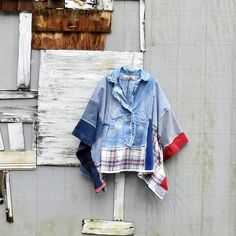 * this upcycled denim poncho will be a fav in your closet for sure! made from 2 pairs of upcycled jeans, flannel and a denim jacket! SIZE - one size fits most Length is around 28 at the shortest point - i can add some length to make it a little longer - just leave me a note at checkout.