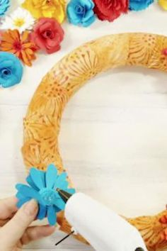 Learn how to make a colorful paper flower wreath to hang on your front door this summer. An easy DIY craft tutorial idea using the Cricut Explore! Budget Crafts, Easy Diy Crafts, Crafts To Sell, Paper Flower Wreaths, Paper Flowers, Mason Jar Crafts, Mason Jar Diy, Handmade Flowers, Diy Flowers