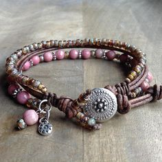 This gemstone bracelet is made with Rhodonite beads, Miyuki beads,leather ,metal beads, a little boho charm and a metal button. Table to convert from cm to inches. 15 cm = 5.90 inch 16 cm = 6.29 inch 17 cm = 6.69 inch 18 cm = 7.08 inch 19 cm = 7.48 inch 20 cm = 7.87 inch 21 cm = 8.26