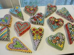 Brightly painted ceramic hearts by Shannon Mitchell