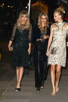 Pin for Later: Bradley and Suki Have Their Most Stylish Night Out Ever  Suki met up with friends Cara Delevingne and Poppy Delevingne outside the reception.