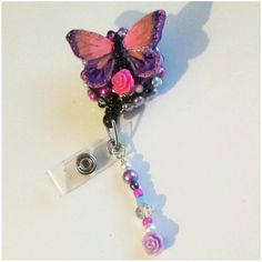Check out this item in my Etsy shop https://www.etsy.com/listing/252044434/decorated-badge-reel-butterfly