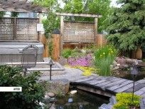 This outdoor living space includes a custom koi pond designed by Ananda Landscapes. What a peaceful atmosphere #landscaping