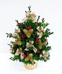 Beautiful tabletop cut boxwood tree decorated for the holiday season with festive trim provides a finishing touch to the holiday decorations. #BlossomFlowerShops Christmas Deco, Christmas Wreaths, Christmas Tree, Cut Flowers, Fresh Flowers, English Boxwood, Boxwood Tree, Tree Decorations, Holiday Decorations