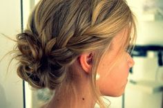 Loose braid into messy bun.  someone please do this to my hair!