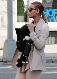 Beyonce Knowles Photos - Singer Beyonce enjoyed yet another stroll with her baby girl Blue Ivy Carter strapped to her chest in New York City, New York on March 13, 2012 - Beyonce Knowles Blue Ivy Carter Out in NYC