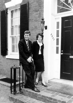 The Kennedy's standing outside their Georgetown home March 1958.