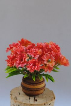 Miniature Bouquet of Flowers in Wooden Pot by Purpose4Everything, $4.25