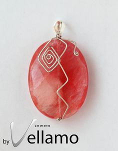 Unique large cherry quartz pendant with sterling silver wire shapes, faceted, 45mm, OOAK. $17.00, via Etsy.