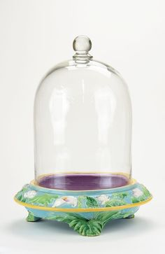 """An Extremely Rare George Jones Majolica 'Calla Lily' Fern Stand c.1875 The turquoise circular base with sloping sides and decorated with a running band of calla lily blossoms and leaves, a pink interior and a large domed glass lid with knob handle, all supported on three leaf feet, 21""""h, 16""""d<br><br>Catalogued and curated by Nicolaus Boston"""