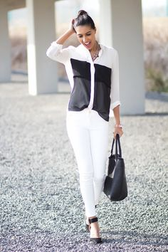 This outfit shows black and white. The white gives a delicate,bright, and open appeal while the black gives the outfit a formal, strong effect.