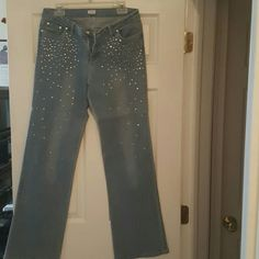 Rhinestone studded jeans These are super cute boot cut jeans with rhinestones on the front and silver studs around front pockets. There are about 5 or 6 rhinestones missing. Cache Jeans Boot Cut