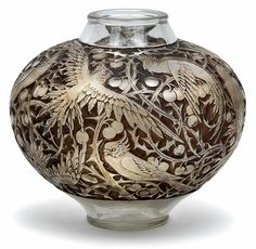 """R. LALIQUE (1860-1945)___. An """"Aras"""" vase,Wingen-sur-Moder, designed in 1924, the mould pressed colourless glass decorated in relief with birds against a backdrop of tendrils against a brownish red patinated ground, bulbous body, the underside with raised signature R. Lalique, height 23 cm [Gorgeous!]"""