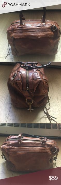 """Taking Offers: Rebecca Minkoff m.a.b. Satchel Pre-owned Rebecca Minkoff m.a.b. Approx 13.5"""" across, 8.75"""" high 8.25"""" wide across bottom. Outside zip pocket. Interior zip pocket, interior patch pocket. Metal hardware. Leather exterior, cloth  lining. Please note: does show signs of wear. Please see detailed photos of seam thread coming apart at left side of front zipper pocket, leather worn down at front left corner to expose interior trim stabilized. Handle leather darkened. Leather shows…"""