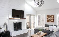 Modern farmhouse living room renovation - the greenspring home Modern Farmhouse Living Room Decor, Modern Farmhouse Plans, Modern Farmhouse Kitchens, Modern Fireplace Mantles, Farmhouse Fireplace, Modern Fireplaces, Farmhouse Rugs, Living At Home, Facade