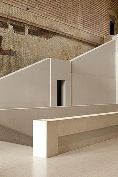 Neues Museum // Berlin. David chipperfield. Selection of institute concrete finishes contrast and complement the existing yellow brick of the interior.