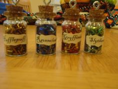 Hogwarts House Glass Vial Necklace. $7.75, via Etsy.