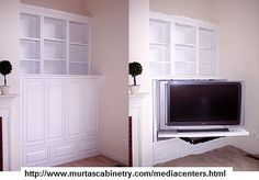 Custom made corner recessed wall media center with bifold pocket doors and a tv pull out swivel easily capable of handling this TV (www. Tall Tv Stands, Plasma Tv Stands, Bedroom Tv Stand, Swivel Tv Stand, Tv Shelf, Flat Panel Tv, Lounge, Home Tv, Wall Mounted Tv