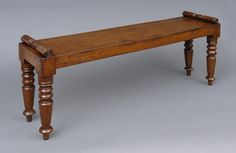"""Miniature oak  hall or window bench with carved bolster ends on turned legs.  Would make a great low end table.      English Circa 1830     Height: 12"""" 
