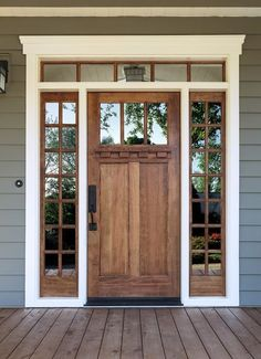 I LOVE this front door and how it has the mirrored window film. It gives it a nice look and since people can't see in, you don't have to worry about built-in blinds or anything.