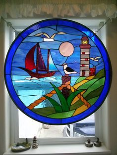 \    Beautiful Lighthouse and sailboat stained glass