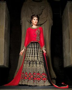 Vivid red and black lehenga style suit with zari floral embroidery 1. Vivid red and black art silk velvet lehenga style suit2. Golden thread zari and sequins floral embroidery all over3. Comes with matching bottom and dupatta4. Can be stitched upto size 44 inches
