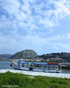Taxi boat moored at #Bourtzi fortress with #Palamidi Castle capping the hill in the background. #Nafplio - #Greece