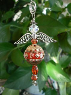 Arabic-inspired orange-red beaded hanging angel by LindaGillottiDesigns on Etsy